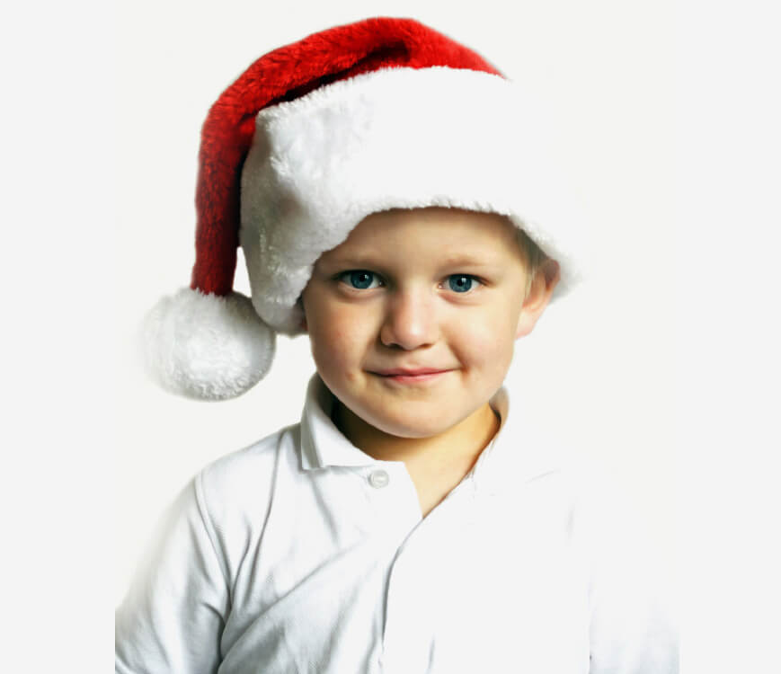 Child in a Santa hat.