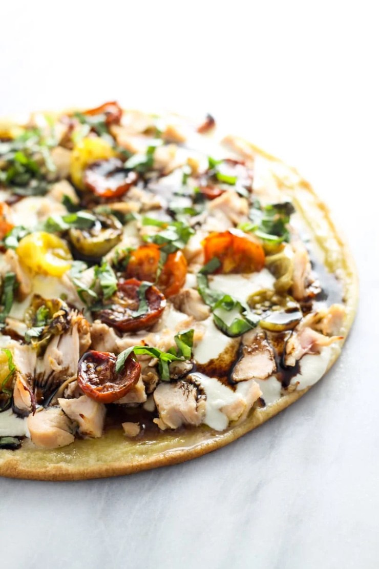 Transform the classic appetizer into a mealtime favorite with this Low Fodmap Bruschetta PIzza with Chicken. Gluten free and full of fresh flavor, this will quickly become a family-favorite recipe!