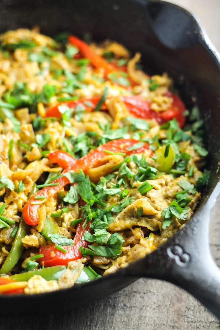 In a breakfast rut?! Try Low Fodmap Fajitas Migas! This recipe is filled with fresh flavors, crispy tortilla chips and CHEESE! Yum!