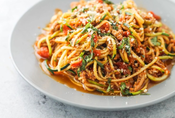 Low Fodmap Spaghetti and Zoodles, a yummy, low carb and lightened up version of the Italian classic. Made with ground turkey, but ground beef or pork work too!