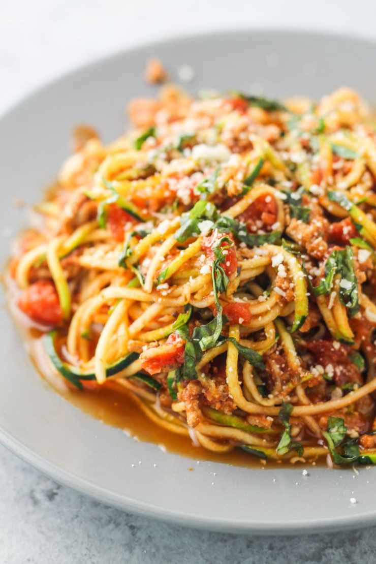 Low Fodmap Spaghetti and Zoodles, a yummy, low carb and lightened up version of the Italian classic. Made with ground turkey, but ground beef or pork can easily be substituted.