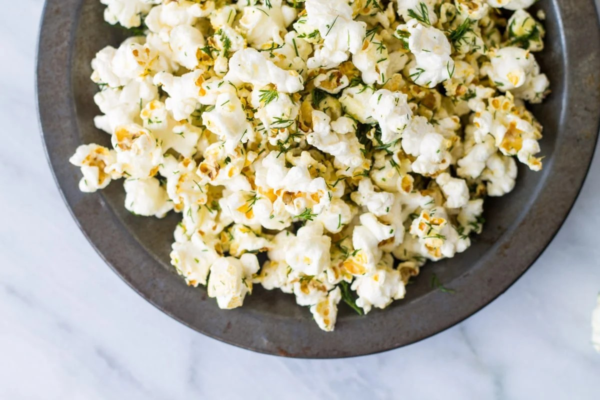 This Low Fodmap Dill Popcorn is one of my favorite low fodmap snacks! Popcorn that tastes like a pickle!