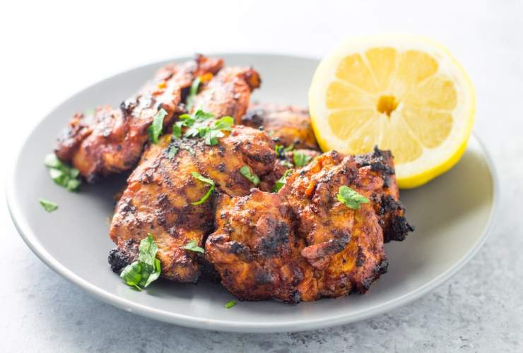 Switch up your typical griled chicken with this spicy, Afro-Portuguese-inspired Low Fodmap Peri Peri Chicken recipe flavored with lemon, paprika and cayenne pepper!