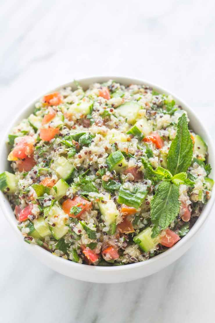 With fresh tomatoes, cucumber, and lots of herbs, Low Fodmap Quinoa Tabbouleh is filled with fresh, Mediterranean-inspired flavor.