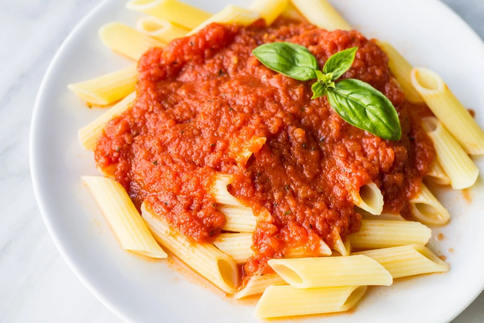 A fantastic Low FODMAP pasta sauce recipe - no onion or garlic needed! Serve over low FODMAP pasta or zucchini noodles for an easy meal!