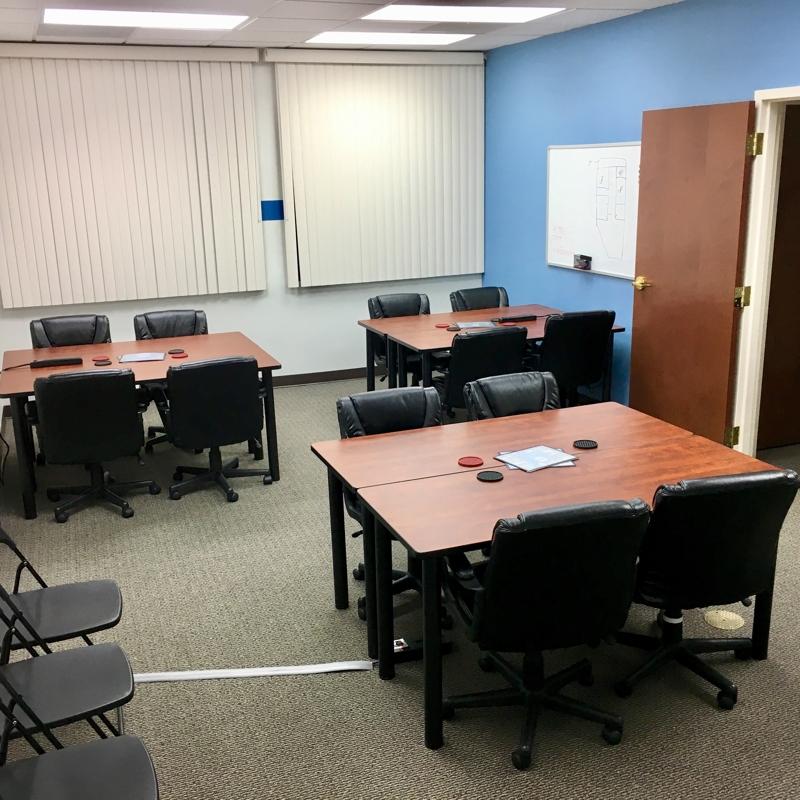 ... Fuquay Coworking Common Shared Desk Area ...