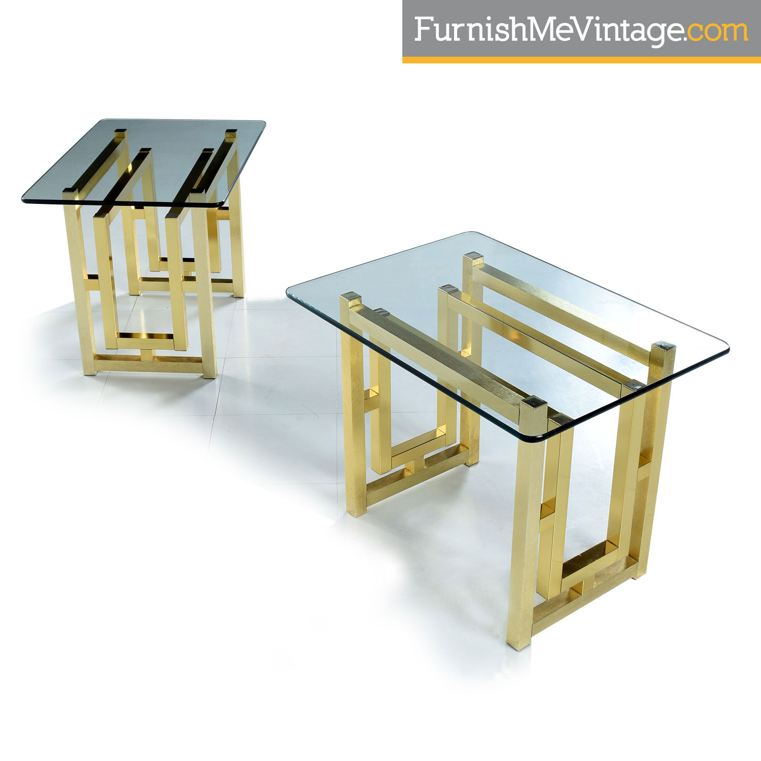 pair of hollywood regency gold colored brass side tables