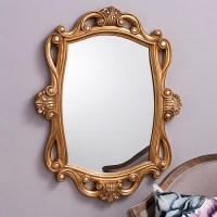 Larissa Decorative Wall Mirror In Gold With Sweeping Curves