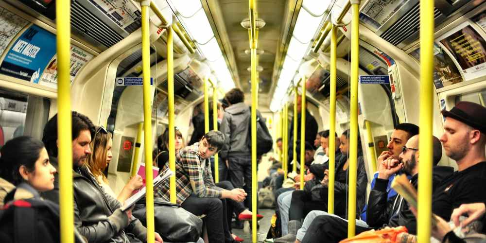 People on a crowded tube train