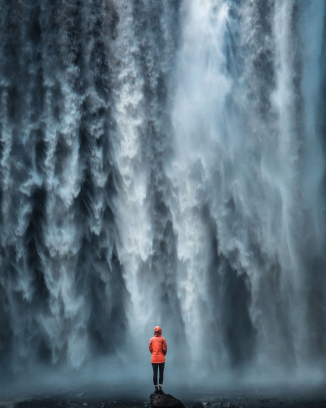 Person in front of waterfall - skogafoss