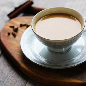 Indian Masala Chai Recipe. An authentic, Indian tea recipe flavored with cardamom, cinnamon, cloves, ginger and sugar. I lOVE making this!! It's a perfect cuppa anytime. | FusionCraftiness.com