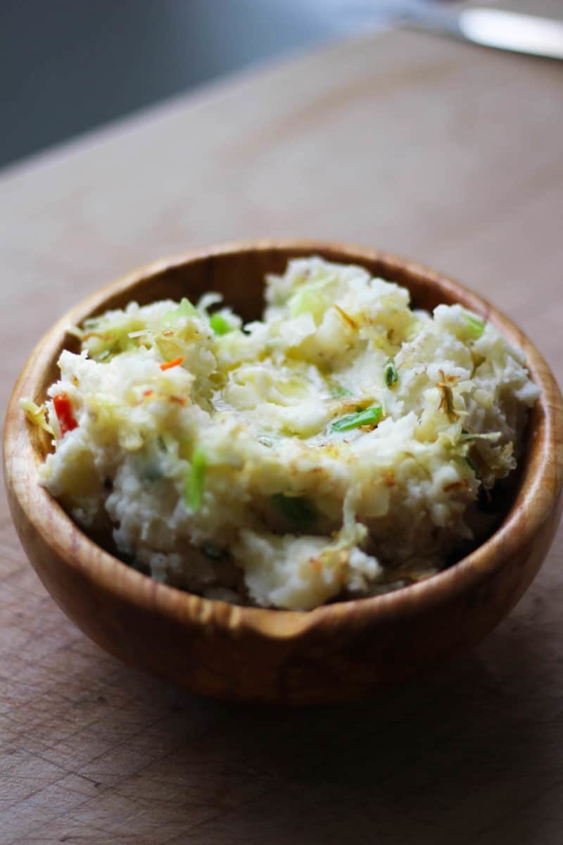 Easy Traditional Irish Colcannon Recipe, a tasty bowl of comfort food that can be whipped up in a snap! Make this the next time you need a hardy side or a meal for St. Patricks Day. | FusionCraftiness.com
