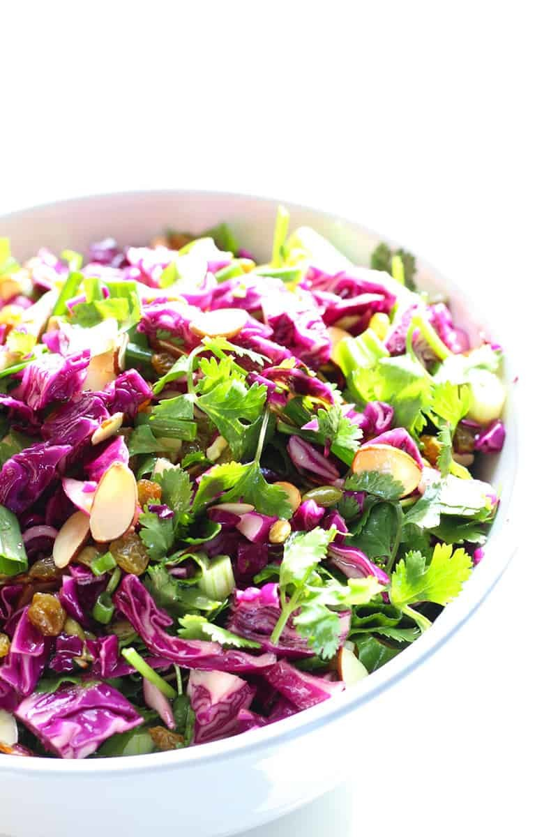 Citrus Summer Slaw With Toasted Almonds & Raisins. Perfect for Summer BBQs, 4th of July and Memorial Day!  FusionCraftiness.com