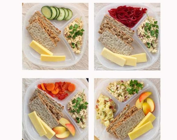 Healthy Scandinavian Lunch Meal Prep. An easy and healthy solution for a healthy new year. Salmon salad is served with nutritious crackers and veggie sides. Prepare lunches for the whole week without the guilt.