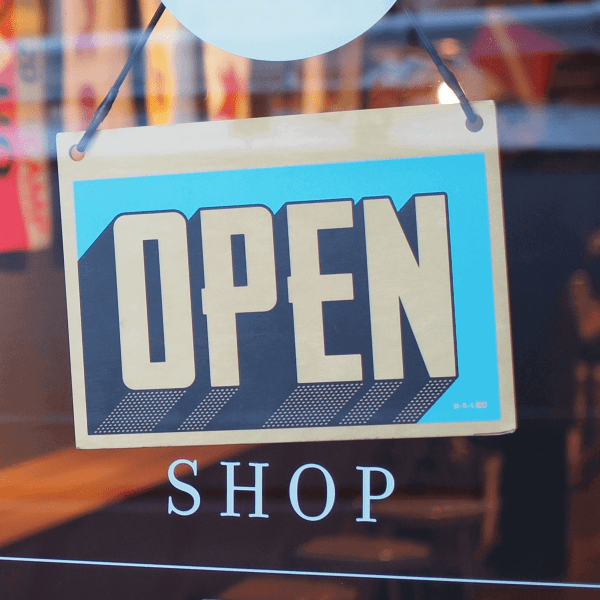 Open sign representing article on growing strategies for your small business