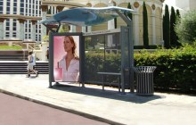 sinewave bus shelter installed at side of road.