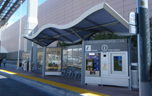 BRT shelter on the side of a road.