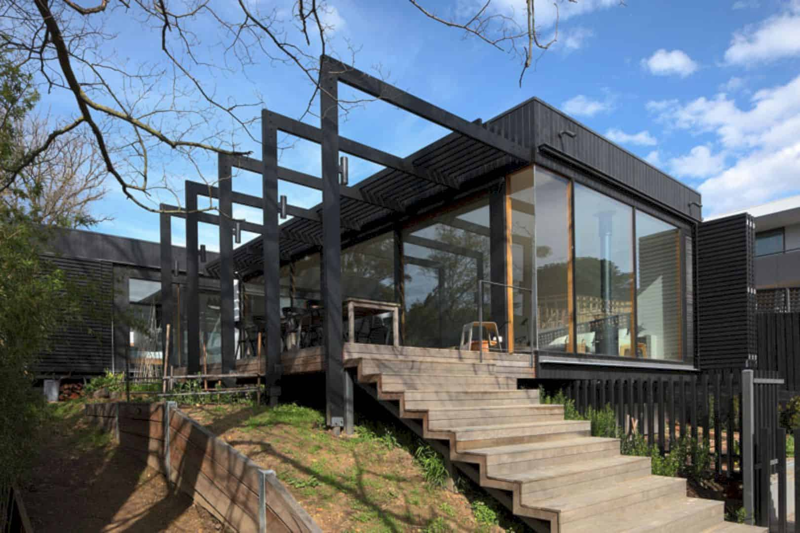 A black wood extension for a victorian house in melbourne for Architecture firms melbourne