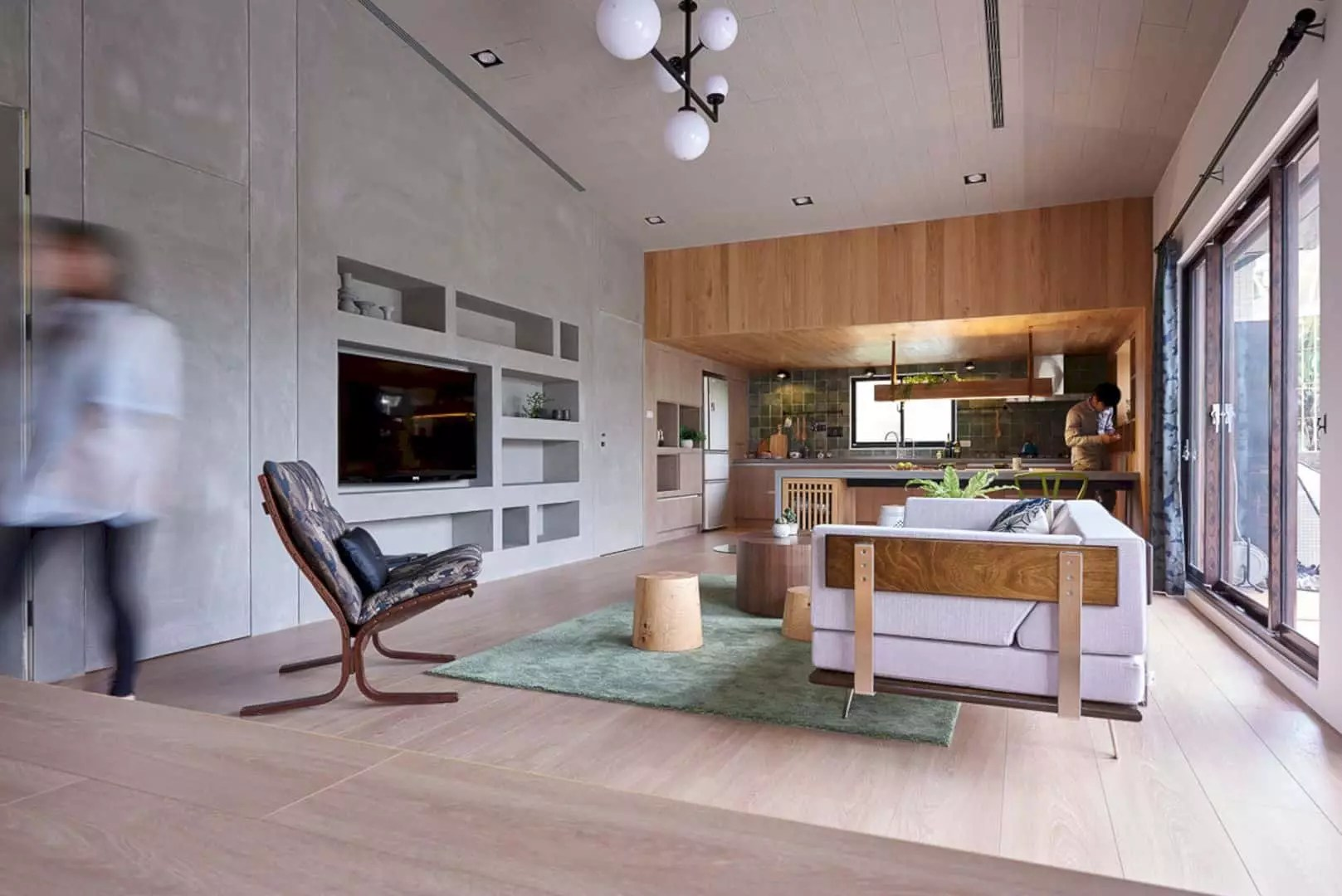 House is merging the dining room and old living room by removing the wall between them the kitchen island design suits well with the modern interior