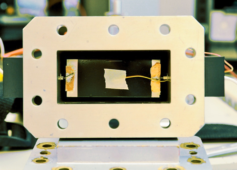 A waveguide frames a graphene nanoribbon film for testing. (Credit: Tour Group/Rice University)
