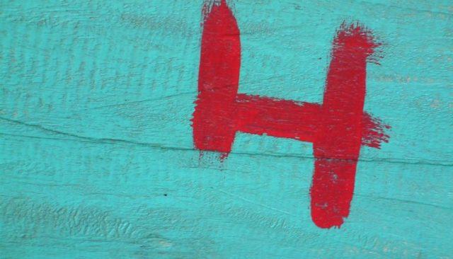 The number 4 painted in red on a blue wall