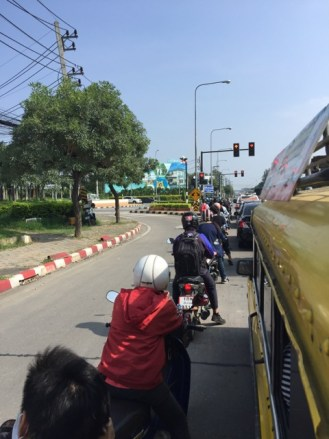Mopeds in queue at traffic light