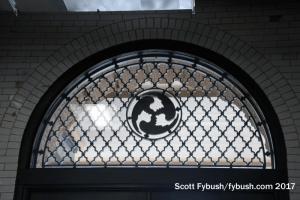Window above track doors