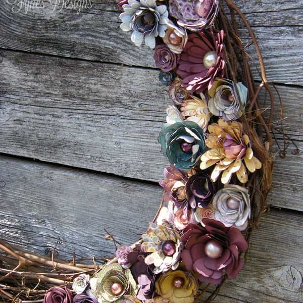 Rolled paper flowers added to a grapevine wreath