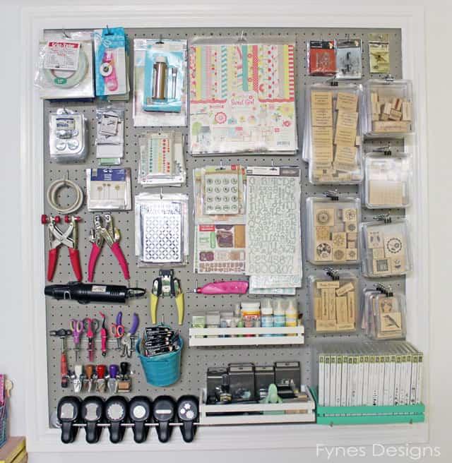 Craft room peg board storage from Fynes Designs.com