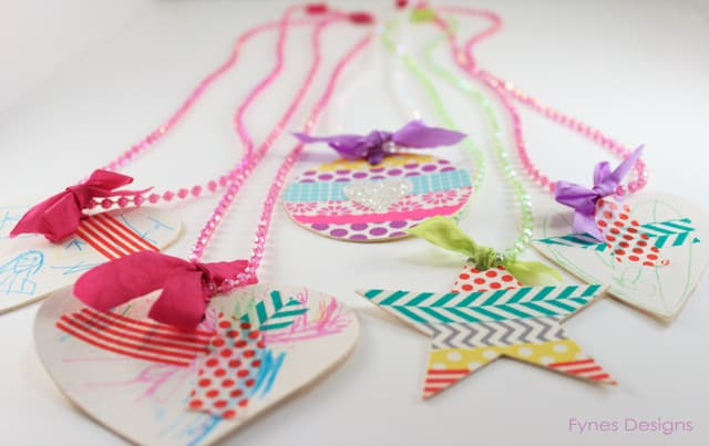 handmade necklaces kids can decorate with washi tape, pens, glitter, stickers, and ribbon