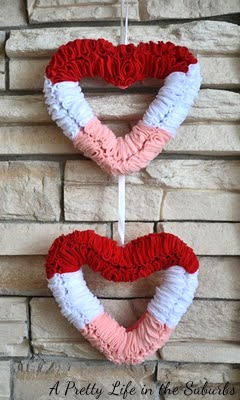 How to make a heart shaped wreath for only $2, a craft featured by top US craft blog, FYNES DESIGNS |Heart Shaped Wreath by popular Canada DIY blog, Fynes Designs: image of a pink, white and red heart shaped wreath.