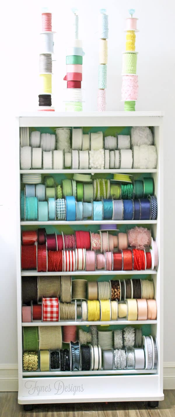 DIY Ribbon Storage Rack Tutorial featured by top US craft blog, FYNES DESIGNS: Turn an old VHS stand into a Ribbon storage rack. Its holding 150 spools!