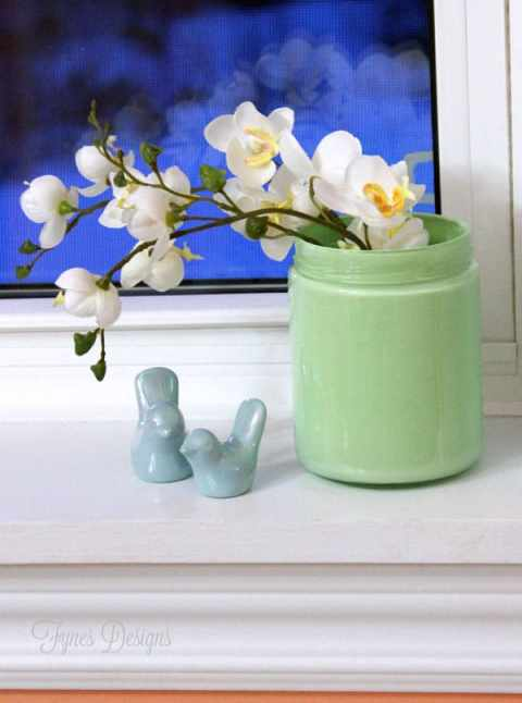 Faux flowers in a mint mason