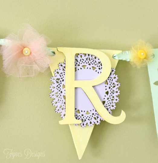 Use wood glue to glue wood Veneer shapes together to create a sweet spring banner