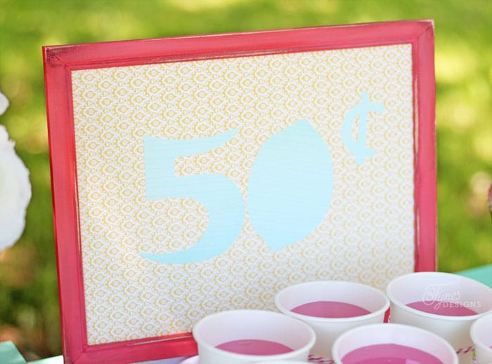 Paint a dollar store frame and use scrapbook paper to decorate it