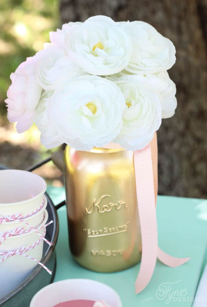 Spray paint mason jars with Metallic spray paint