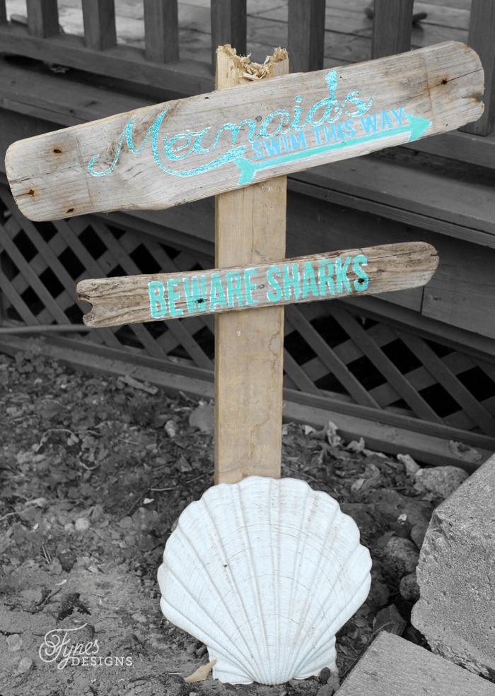 Mermaids swim this way painted sign