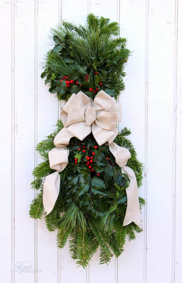 Learn to make a Christmas swag with this easy to follow tutorial. Easy outdoor Christmas decorations