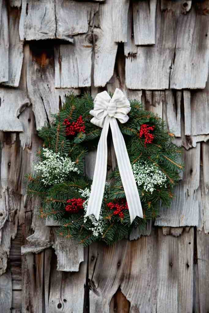 Easy to follow tutorial - How to make a Christmas wreath | Christmas Wreath by popular Canada DIY blog, Fynes Designs: Pinterest image of a traditional Christmas wreath.