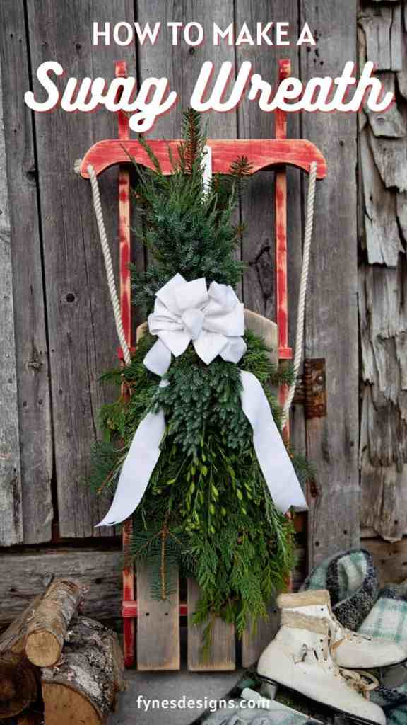 How to Make a Swag Christmas Wreath, a tutorial featured by top US life and style blog, Fynes Designs |Swag Wreath by popular Canada DIY blog, Fynes Designs: Pinterest image of a swag wreath hanging on a wooden sled.