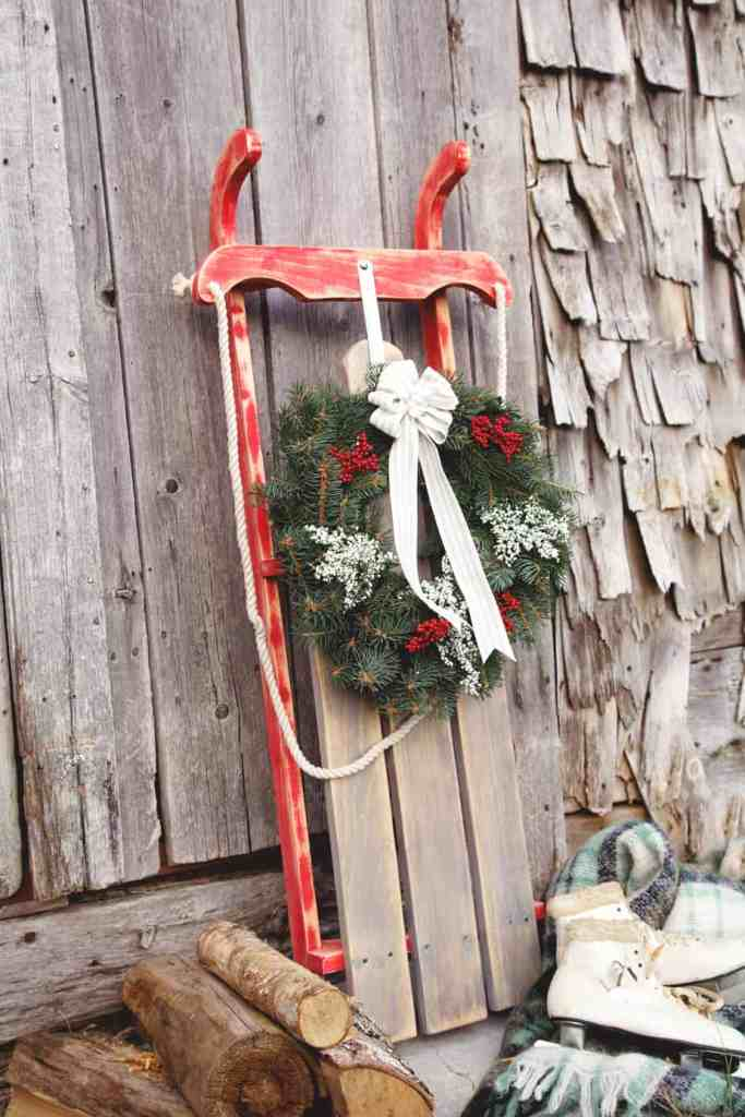 How to build your own Vintage Sled for only $10! |Bottle Brush Tress by popular Canada DIY blog, Fynes Designs: Pinterest image of a wooden