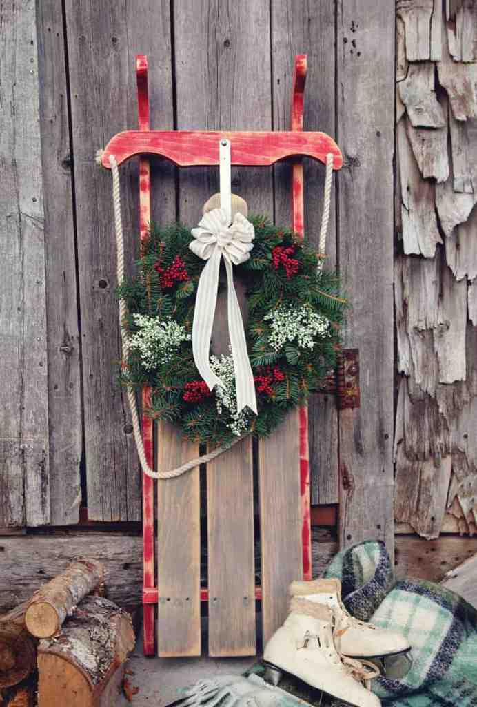 Vintage Sled DIY with a FREE pattern. Only $10! |Joy Sign by popular DIY Canada blog: image of a vintage wooden sled with a pink wreath hanging from it.