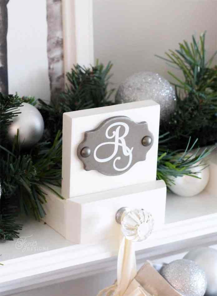 Easy Build Monogrammed Stocking Holders with Pretty Decorative Knobs - Tutorial via Fynes Designs #diystockinghangers #christmasstockinghangers #stockinghangers #handmadestockinghangers #christmasstockinghangerstomake #christmasdecorations #diychristmasdecorations