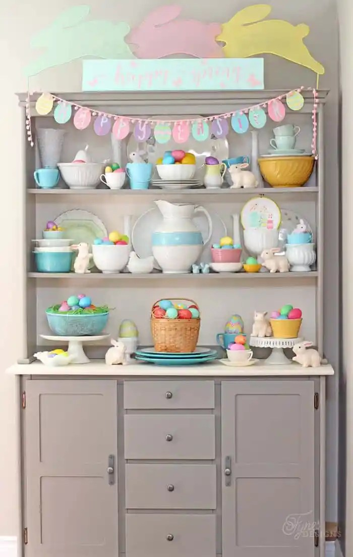 Bright and fun Easter hutch using plastic easter eggs, and dollar store bunnies