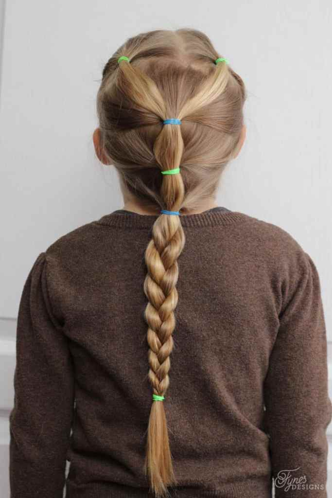 Lets start with the basic foundation hairdo- part the hair evenly and tie the front of the hair into two small pigtails. Tie back into a ponytail. Nape of the neck stays in best. |5 Minute Hairstyles by popular Canada lifestyle blog, Fynes Designs: image of a braid ponytail hairstyle.