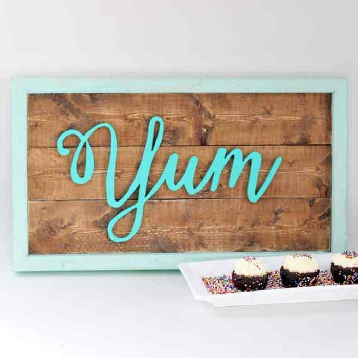 Yum wood sign in aqua