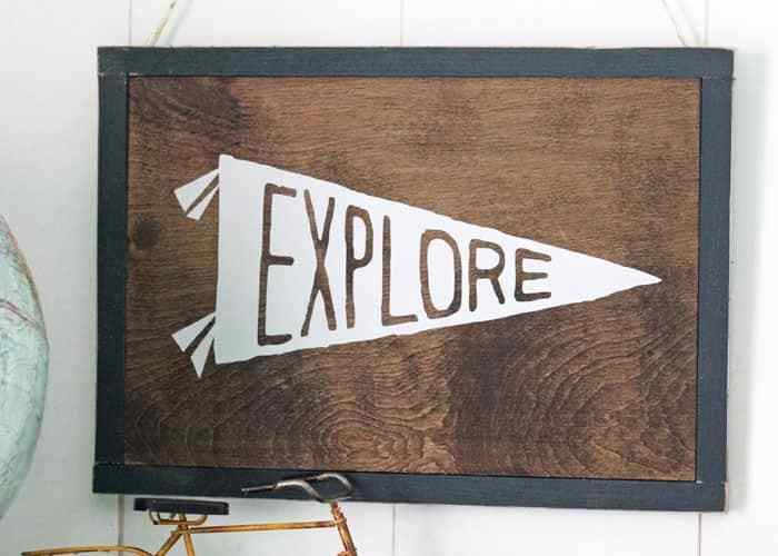 How to Use Heat Transfer Vinyl on Wood, a tutorial featured by top US home decor blog, Fynes Designs | Did you know you can use HTV on wood?! Looks and feels like paint . Works awesome for fine lines- click to learn how to make this explore sign