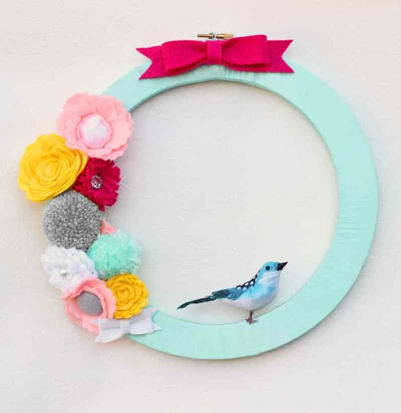 Create this wreath by ribbon wrapping two different size embroidery hoops together