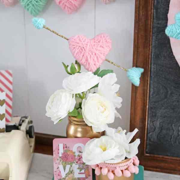 Wrap styrofoam hearts in yarn for a kid friendly Valentine's Day craft