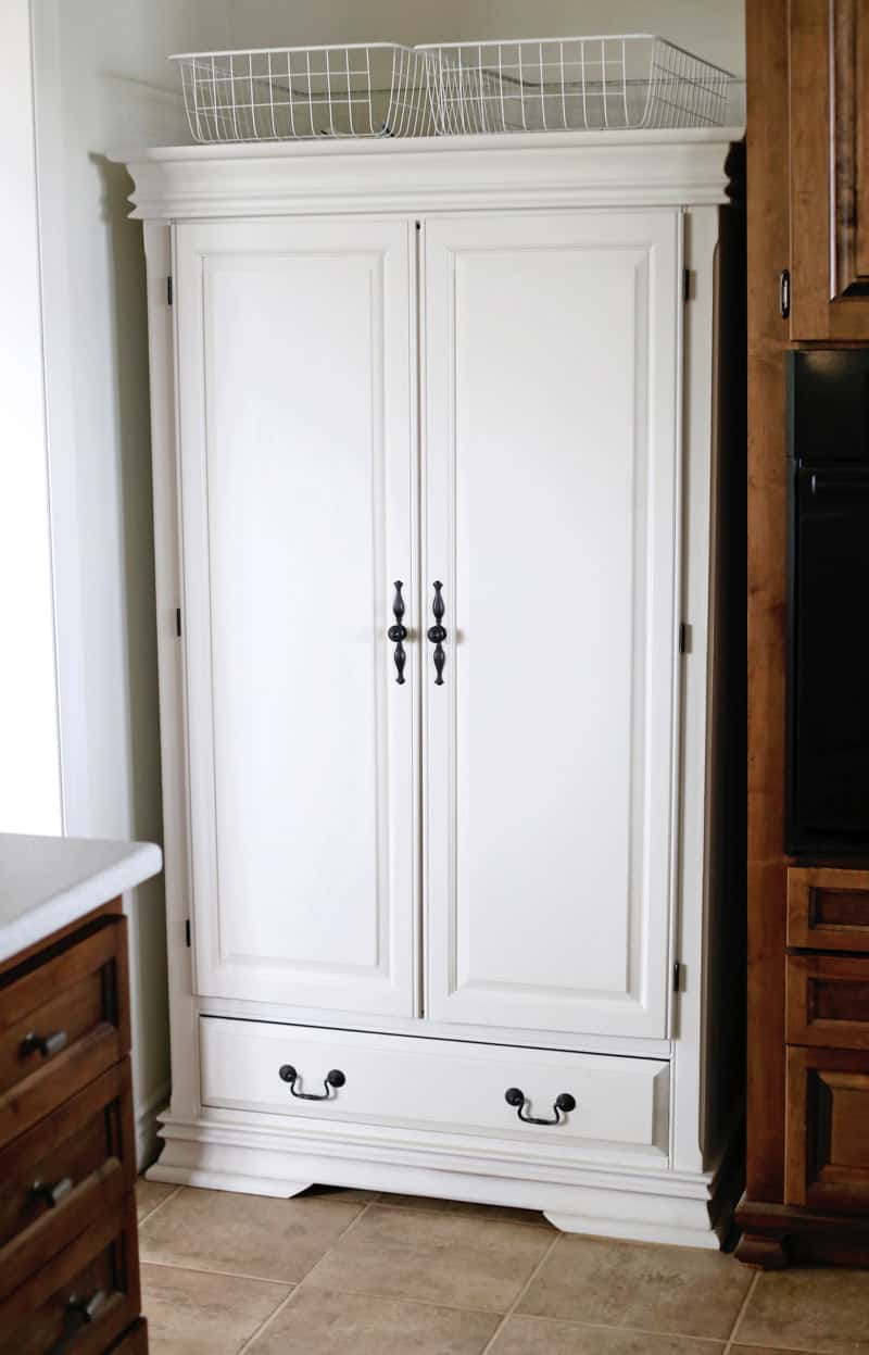 Bedroom armoire used as a farmhouse kitchen pantry